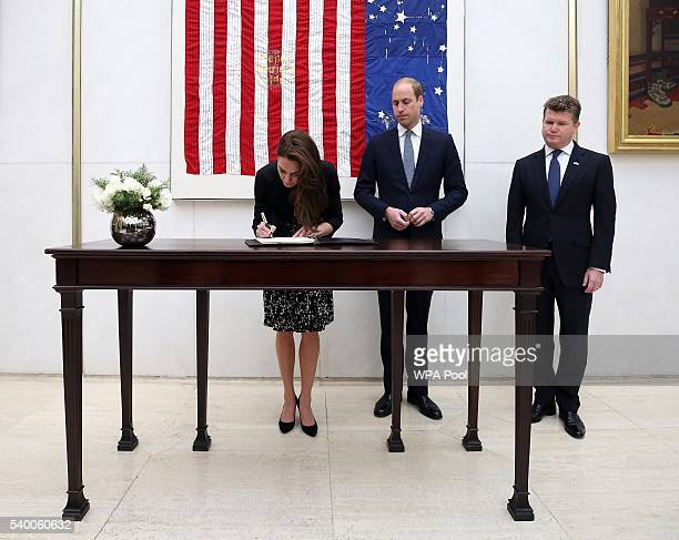 Catherine Duchess of Cambridge signs a book of condolence for the Orlando mass shooting victims while Prince WIlliam The Duke of Cambridge and...