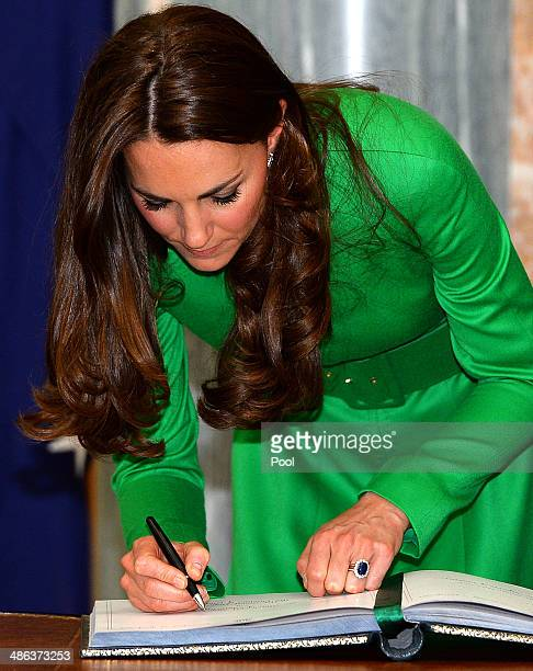 Catherine Duchess of Cambridge signs a visitors book following a reception at the Parliament House on April 24 2014 in Canberra Australia The Duke...