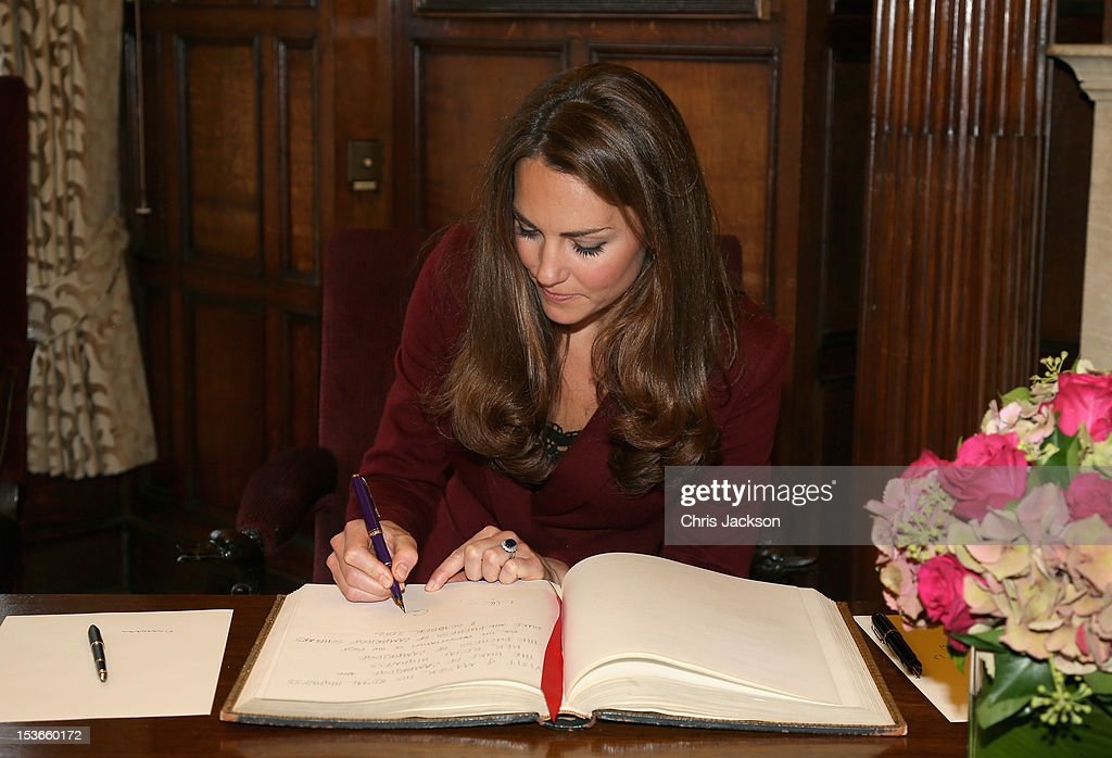 <a gi-track='captionPersonalityLinkClicked' href=/galleries/search?phrase=Catherine+-+Duchess+of+Cambridge&family=editorial&specificpeople=542588 ng-click='$event.stopPropagation()'>Catherine</a>, Duchess of Cambridge signs the visitors book as she visits Middle Temple on October 8, 2012 in London, England. The Duke of Cambridge, Master of the Bench, and The Duchess of Cambridge met recipients of the Queen Mother Scholarship, the Diana, Princess of Wales Scholarship and the Duke and Duchess of Cambridge Scholarships at Middle Temple Inn, London.