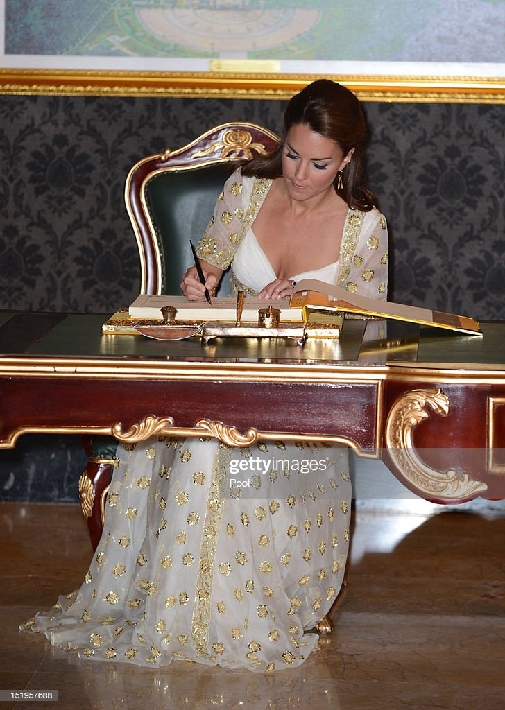 Catherine, Duchess of Cambridge signs the visitors' book during an official dinner hosted by Malaysia's Head of State Sultan Abdul Halim Mu'adzam Shah of Kedah on Day 3 of Prince William, Duke of Cambridge and Catherine, Duchess of Cambridge's Diamond Jubilee Tour of South East Asia at the Istana Negara on September 13, 2012 in Kuala Lumpur, Malaysia. Prince William, Duke of Cambridge and Catherine, Duchess of Cambridge are on a Diamond Jubilee Tour of South East Asia and the South Pacific taking in Singapore, Malaysia, Solomon Islands and Tuvalu.