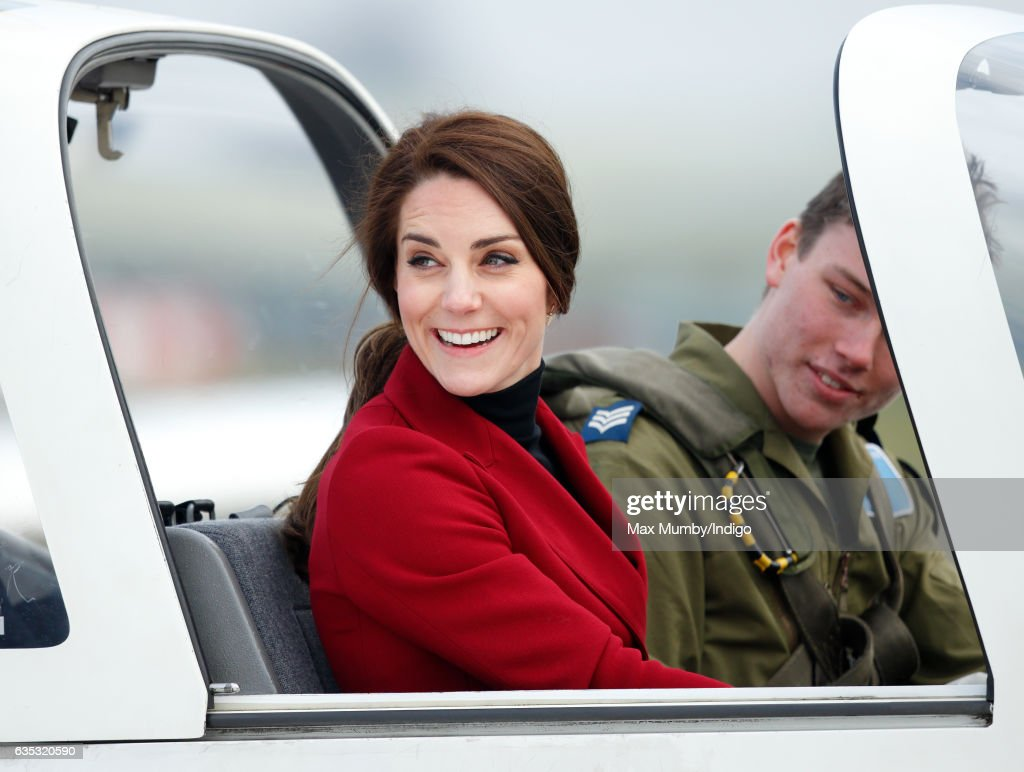Catherine, Duchess of Cambridge sits in the cockpit of a Grob 115E 'Tutor' aeroplane during a visit to RAF Wittering to meet air cadets taking part in a half-term skills development camp on February 14, 2017 in Stamford, England. The Duchess of Cambridge is Royal Patron and Honorary Air Commandant of the Air Cadet Organisation.