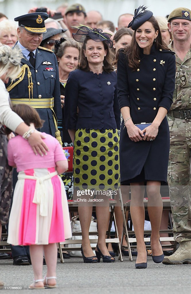 Catherine, Duchess of Cambridge smiles as she attends the Irish Guards Medal Parade at the Victoria Barracks on June 25, 2011 in Windsor, England. The Duchess of Cambridge and Duke of Cambridge are at the barracks to present service medals to members of the Irish Guards