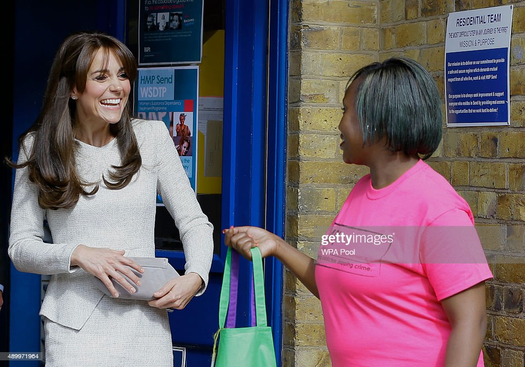 Catherine, Duchess of Cambridge smiles as she is handed a gift by Isha Walker who is on the RAPt programme during a visit to the Rehabilitation of Addicted Prisoners Trust at HMP Send on September 25, 2015 in Woking, United Kingdom.