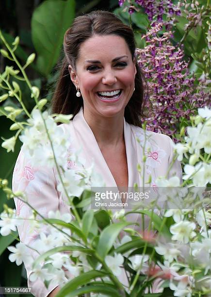 Catherine Duchess of Cambridge smiles as she looks at an orchid named in honour of Diana Princess of Wales at Singapore Botanical Gardens ahead of a...