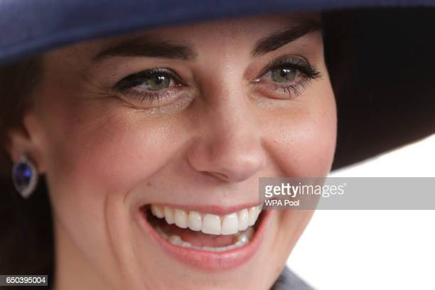 Catherine Duchess of Cambridge smiles as she meets veterans and serving members of the British armed forces at a reception following the unveiling of...