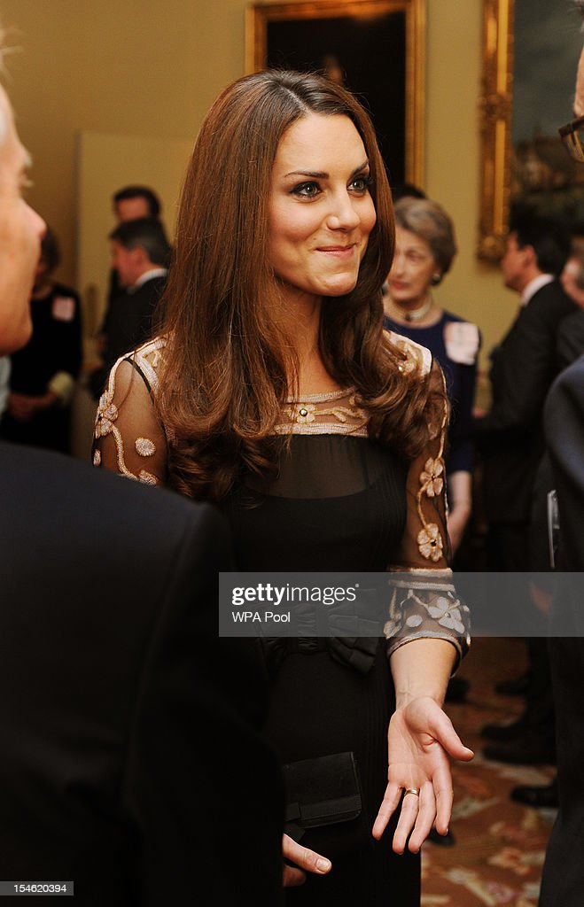 <a gi-track='captionPersonalityLinkClicked' href=/galleries/search?phrase=Catherine+-+Duchess+of+Cambridge&family=editorial&specificpeople=542588 ng-click='$event.stopPropagation()'>Catherine</a>, Duchess of Cambridge smiles as she talks to athletes during a reception held for Team GB Olympic and Paralympic London 2012 medalists at Buckingham Palace on October 23, 2012 in London, England.