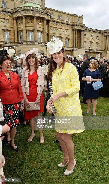 Catherine Duchess of Cambridge smiles as she talks to guests at a Garden Party in the grounds of Buckingham Palace hosted by Queen Elizabeth II on...