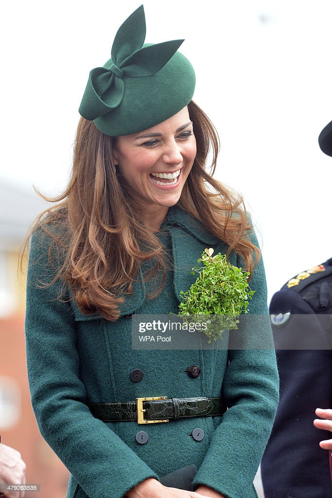Catherine, Duchess of Cambridge smiles as she visits the 1st Battalion Irish Guards during the St Patrick's Day parade at Mons Barracks on March 17, 2014 in Aldershot, England. Catherine, Duchess of Cambridge and Prince William, Duke of Cambridge visited the 1st Battalion Irish Guards to present the traditional sprigs of Shamrocks to the Officers and Guardsmen of the Regiment.