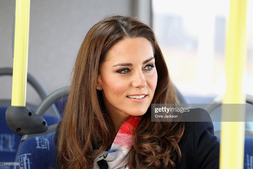 Catherine, Duchess of Cambridge smiles as she wears the Team GB Official Supporter's Scarf for London 2012 before meeting the GB HockeyTeam at the Riverside Arena in the Olympic Park on March 15, 2012 in London, England. The Duchess of Cambridge viewed the Olympic park as well as meeting members of the men's and women's GB Hockey teams.