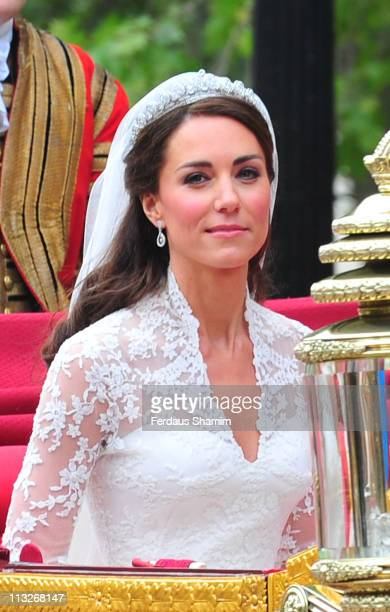 Catherine Duchess of Cambridge smiles at the cheering crowds as she departs Westminster Abbey after her marriage to Prince William on April 29 2011...