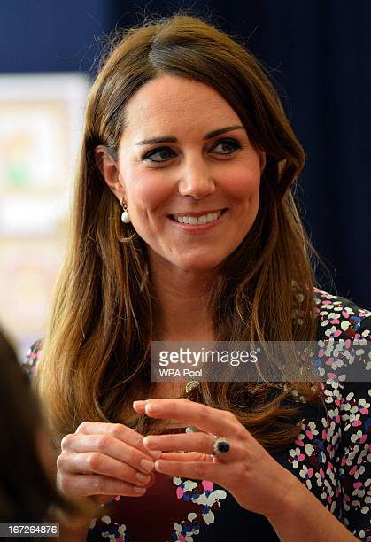 Catherine Duchess of Cambridge smiles during her visit to The Willows Primary School Wythenshawe to launch a new school counseling program on April...