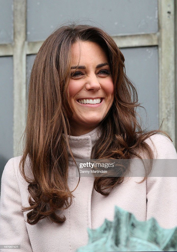 Catherine, Duchess of Cambridge smiles to the crowds from the balcony of Cambridge Guildhall as she pays an official visit to Cambridge with Prince William, Duke of Cambridge on November 28, 2012 in Cambridge, England.