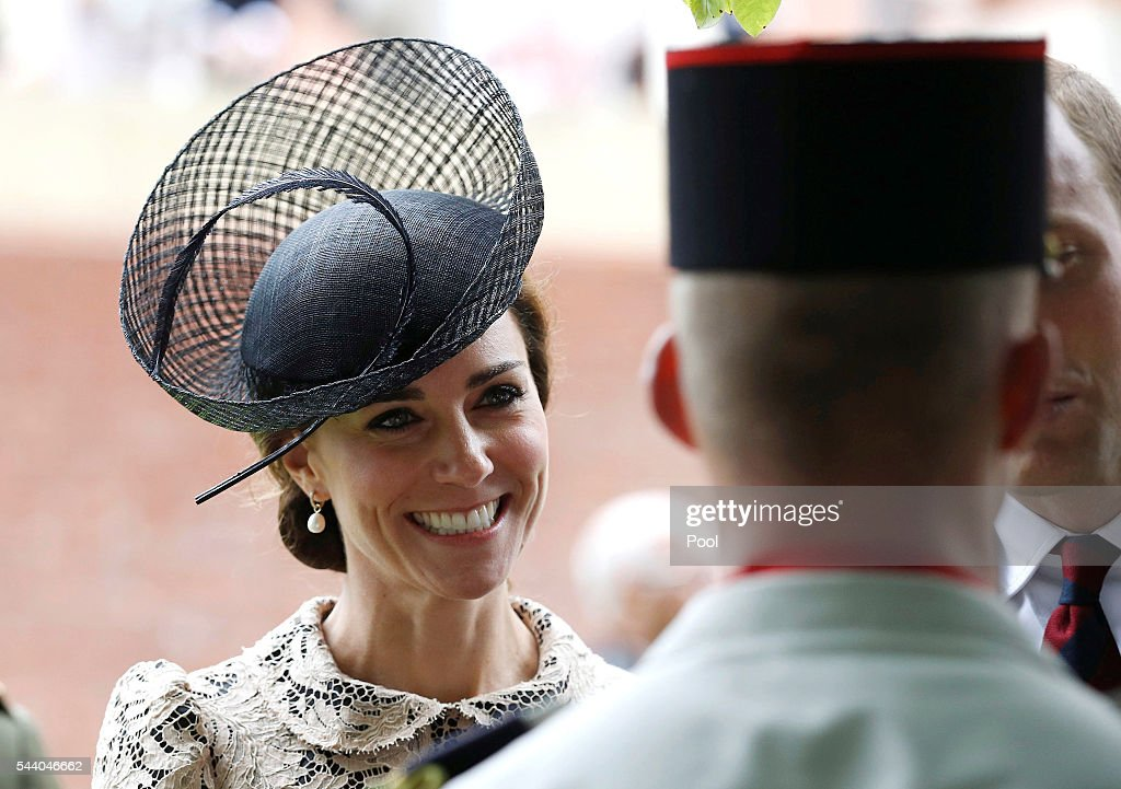 Catherine, Duchess of Cambridge speaks to a soldier during the 100th anniversary of the beginning of the Battle of the Somme at the Thiepval memorial to the Missing on July 1, 2016 in Thiepval, France. The event is part of the Commemoration of the Centenary of the Battle of the Somme at the Commonwealth War Graves Commission Thiepval Memorial in Thiepval, France, where 70,000 British and Commonwealth soldiers with no known grave are commemorated.