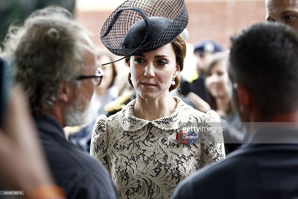 Catherine, Duchess of Cambridge speaks to a visitor during the 100th anniversary of the beginning of the Battle of the Somme at the Thiepval memorial to the Missing on July 1, 2016 in Thiepval, France. The event is part of the Commemoration of the Centenary of the Battle of the Somme at the Commonwealth War Graves Commission Thiepval Memorial in Thiepval, France, where 70,000 British and Commonwealth soldiers with no known grave are commemorated.