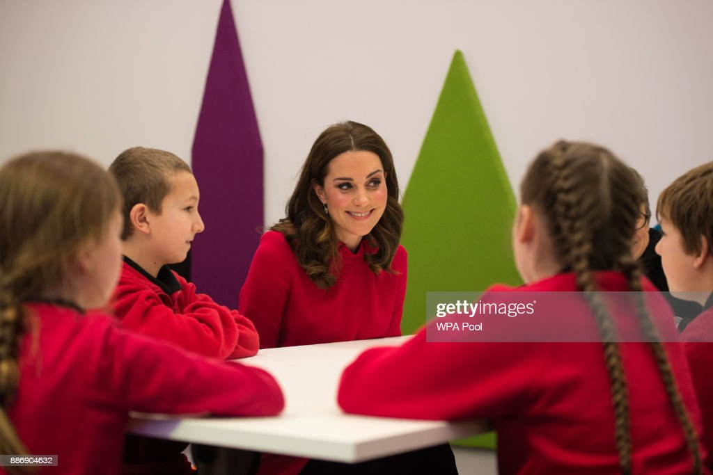 Catherine, Duchess of Cambridge speaks to children as she meets school children during a 'Stepping Out' session at MediaCityUK on December 6, 2017 in Salford, England.