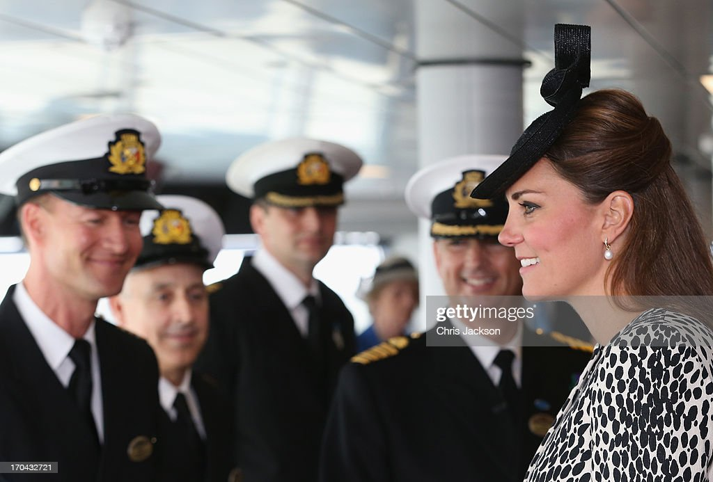 Catherine, Duchess of Cambridge speaks to crew during a tour on board the Princess Cruises ship during its naming ceremony at Ocean Terminal on June 13, 2013 in Southampton, England.