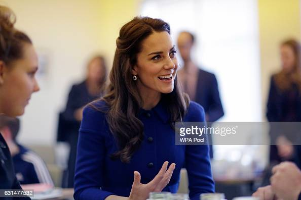 Catherine Duchess of Cambridge speaks to families at the Child Bereavement UK Centre in Stratford on January 11 2017 in London England