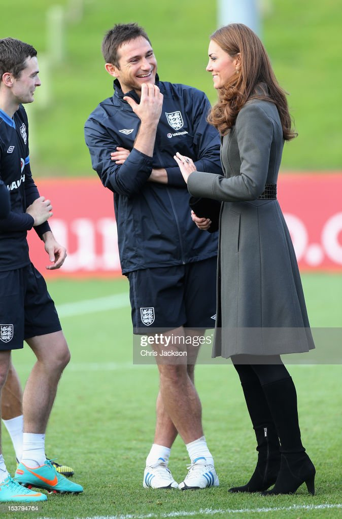 Catherine, Duchess of Cambridge speaks to <a gi-track='captionPersonalityLinkClicked' href=/galleries/search?phrase=Frank+Lampard+-+Born+1978&family=editorial&specificpeople=11497645 ng-click='$event.stopPropagation()'>Frank Lampard</a> of England during the official launch of The Football Association's National Football Centre at St George's Park on October 9, 2012 in Burton-upon-Trent, England.