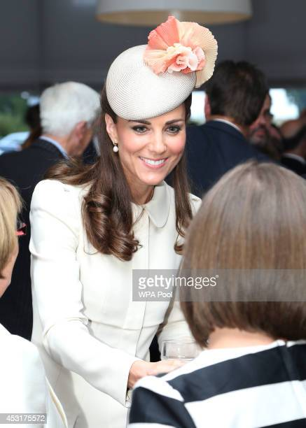Catherine Duchess of Cambridge speaks to guests after a ceremony at St Symphorien Military Cemetery on August 4 2014 in Mons Belgium Monday 4th...