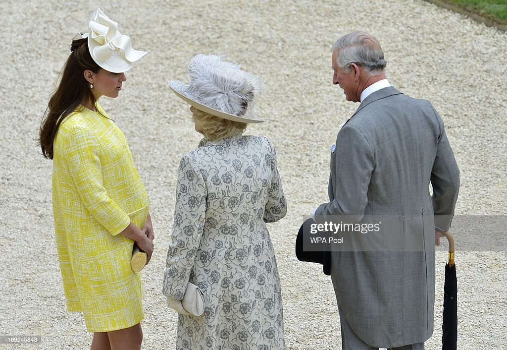 Catherine, Duchess of Cambridge speaks to her mother-in-law Camilla, Duchess of Cornwall as Prince Charles, Prince of Wales looks on as they attend a Garden Party in the grounds of Buckingham Palace hosted by Queen Elizabeth II on May 22, 2013.