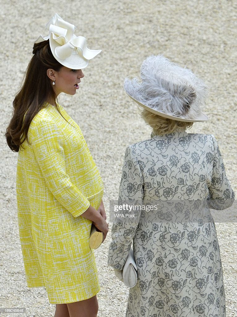 Catherine, Duchess of Cambridge speaks to her mother-in-law Camilla, Duchess of Cornwall as they attend a Garden Party in the grounds of Buckingham Palace hosted by Queen Elizabeth II on May 22, 2013.
