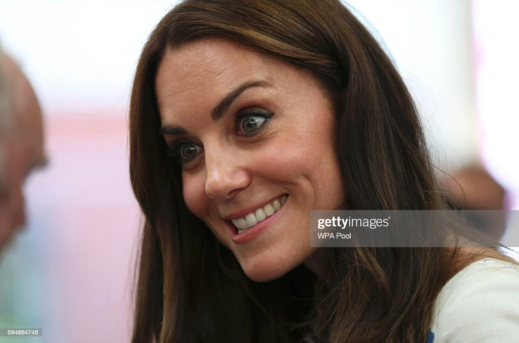Catherine Duchess of Cambridge speaks to patients during a visit to Keech Hospice Care on August 24 2016 in Luton England The Duke and Duchess...