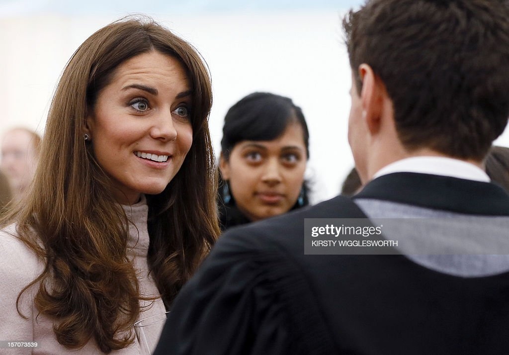 Catherine, Duchess of Cambridge (L), speaks to university staff during a visit to Senate House in Cambridge on November 28, 2012. Britain's Prince William and his wife Catherine visited the university city that is home to their dukedom for the first time since they were given their official titles. William and Catherine, who were given the titles the Duke and Duchess of Cambridge when they married last year, received an ecstatic welcome from hundreds of people who started lining the streets in the early hours of the morning.