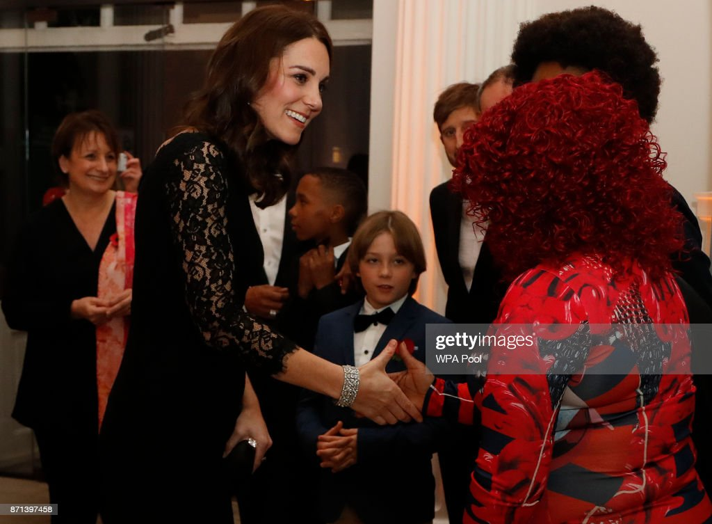 Catherine, Duchess of Cambridge speaks to various guests at the 2017 Gala Dinner for The Anna Freud National Centre for Children and Families (AFNCCF) at Kensington Palace on November 7, 2017 in London, England.