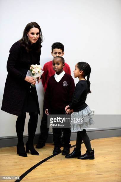 Catherine Duchess of Cambridge speaks to Yahya Hussein Ali and Dawud Wahabi children affected by the Grenfell Tower fire at its community centre in...