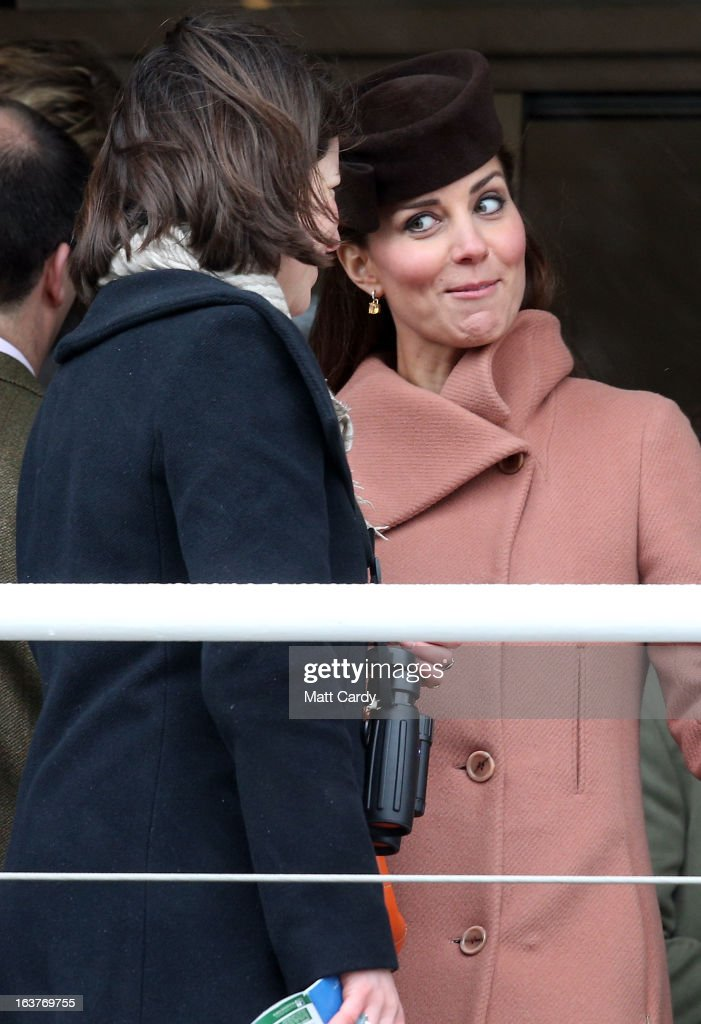 Catherine, Duchess of Cambridge speaks with a fellow racegoer as they watch the races on Gold Cup Day at Cheltenham Racecourse on the fourth and final day of the Cheltenham Festival 2013 on March 15, 2013 in Cheltenham, England. Approximately 200,000 racing enthusiasts are expected at the four-day festival, which ends today and is seen as many as the highlight of the jump racing calendar