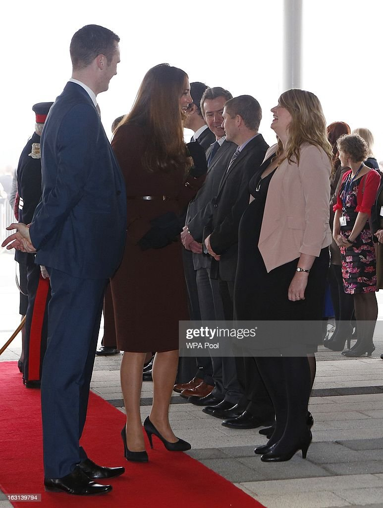 Catherine, Duchess of Cambridge speaks with a pregnant woman during a visit to the Havelock Academy on March 5, 2013 in Grimsby, England.