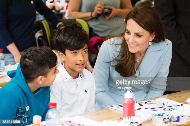 Catherine Duchess of Cambridge speaks with children as she tours a cycling themed festival and unveils a mural of British cyclist Tom Simpson and...