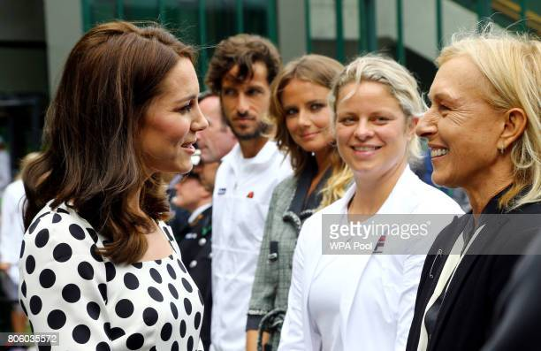 Catherine Duchess of Cambridge speaks with ex tennis players Kim Clijsters and Martina Navratilova on day one of the Wimbledon Championships at The...