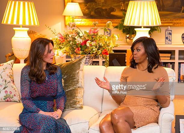 Catherine Duchess of Cambridge speaks with First Lady of the United States Michelle Obama in the Drawing Room of Apartment 1A Kensington Palace as...