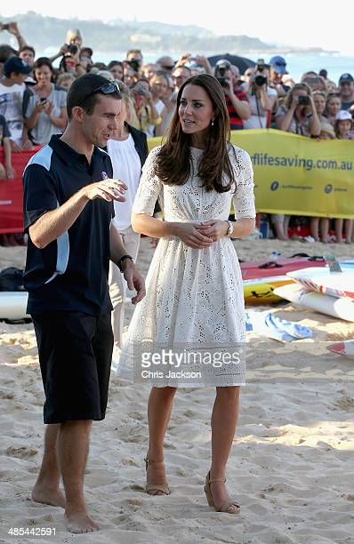 Catherine Duchess of Cambridge speaks with former Australian surf lifesaving team member Chris Allum during a lifesaving event on Manly Beach on...