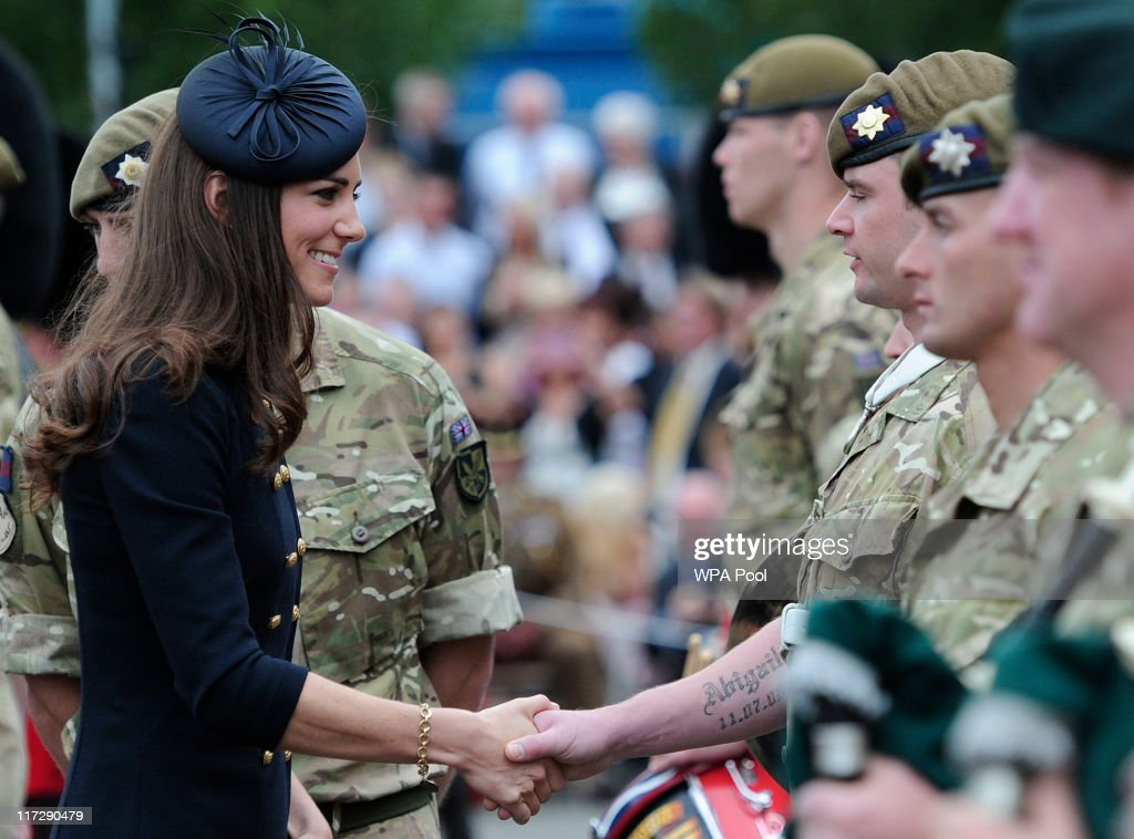 Catherine, Duchess of Cambridge speaks with soldiers in Victoria Barracks during a medal parade for the 1st Battalion Irish Guards Regiment on June 25, 2011, in Windsor, United Kingdom .