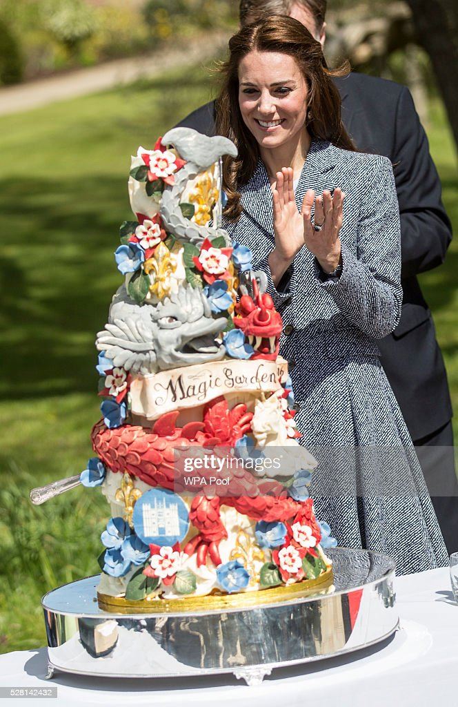 <a gi-track='captionPersonalityLinkClicked' href=/galleries/search?phrase=Catherine+-+Duchessa+di+Cambridge&family=editorial&specificpeople=542588 ng-click='$event.stopPropagation()'>Catherine</a>, Duchess of Cambridge stands next to an ornate cake decorated with dragons and magical creatures baked especially for the opening as she officially opens The Magic Garden at Hampton Court Palace on May 4, 2016 in London, England.