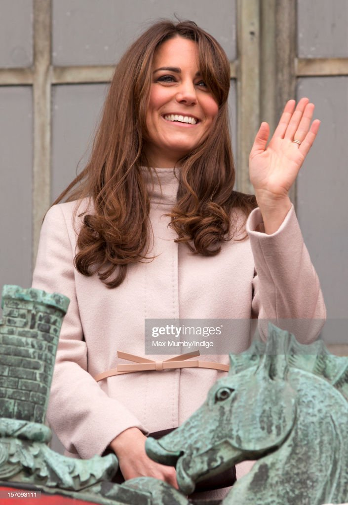<a gi-track='captionPersonalityLinkClicked' href=/galleries/search?phrase=Catherine+-+Duchess+of+Cambridge&family=editorial&specificpeople=542588 ng-click='$event.stopPropagation()'>Catherine</a>, Duchess of Cambridge stands on the balcony of The Guildhall during her and husband Prince William, Duke of Cambridge's first official visit to Cambridge on November 28, 2012 in Cambridge, England.