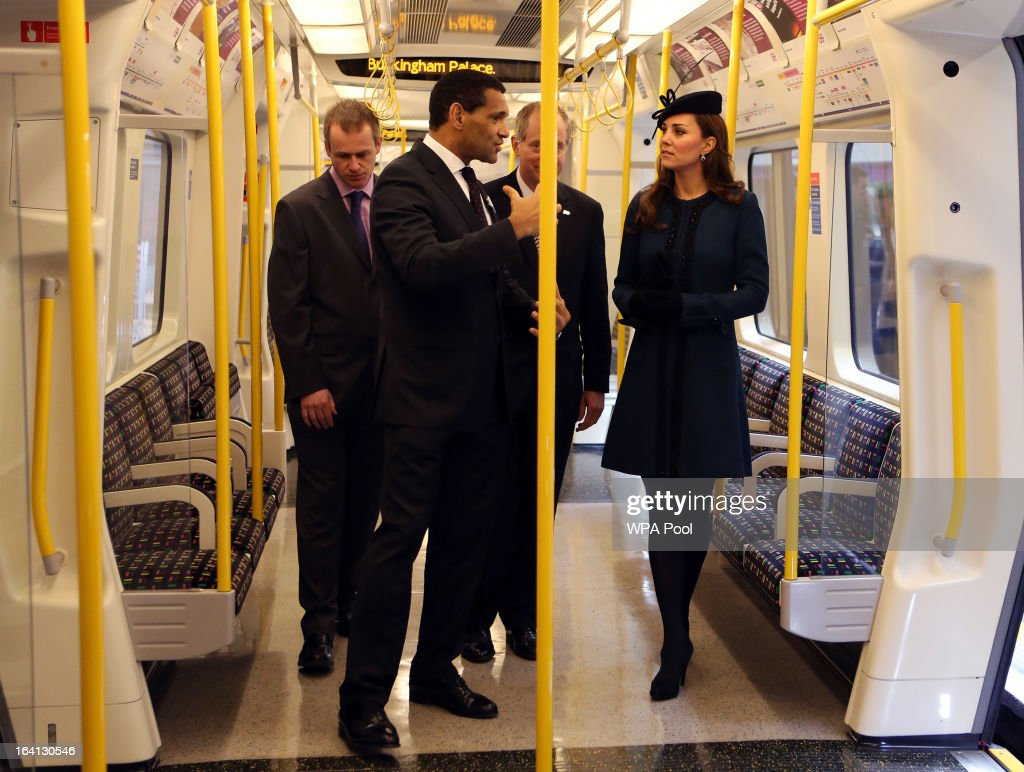 Catherine, Duchess of Cambridge stands onboard a train as she makes an official visit to Baker Street Underground Station, to mark 150th anniversary of the London Underground on March 20, 2013 in London, England.