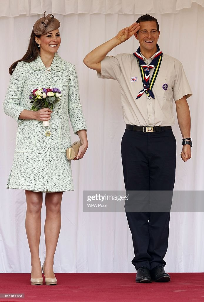 <a gi-track='captionPersonalityLinkClicked' href=/galleries/search?phrase=Catherine+-+Duchess+of+Cambridge&family=editorial&specificpeople=542588 ng-click='$event.stopPropagation()'>Catherine</a>, Duchess of Cambridge stands with Chief Scout <a gi-track='captionPersonalityLinkClicked' href=/galleries/search?phrase=Bear+Grylls&family=editorial&specificpeople=3061585 ng-click='$event.stopPropagation()'>Bear Grylls</a> (R) as she watches a march past of several hundred scouts as she attends a national celebration for scouts who have achieved their Queen's Scout Awards at Windsor Castle on April 21, 2013.