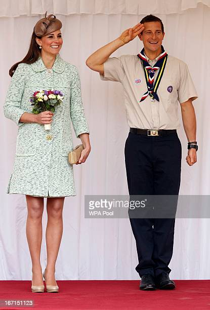Catherine Duchess of Cambridge stands with Chief Scout Bear Grylls as she watches a march past of several hundred scouts as she attends a national...