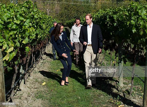 Catherine Duchess of Cambridge stumbles as she walks through the vineyard with Prince William Duke of Cambridge visit the Amisfield Winery on April...