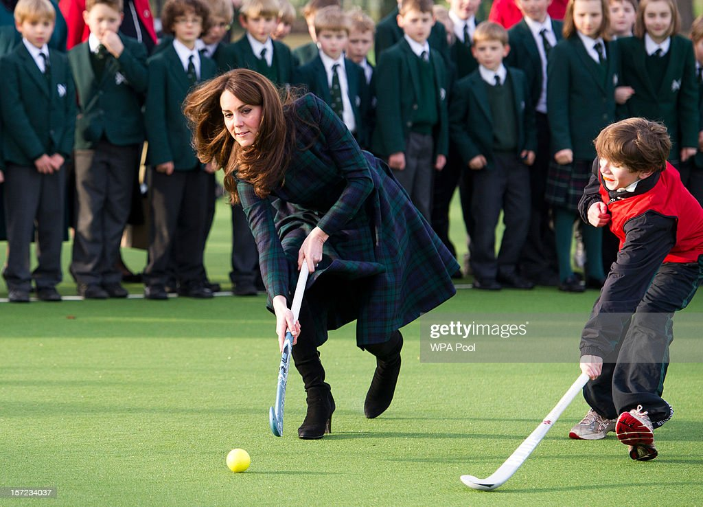 Catherine, Duchess of Cambridge (C) takes part in a day of activities and festivities to mark the occasion of St Andrew's Day at St Andrew's School on November 30, 2012 in Pangbourne, Berkshire, England. The Duchess visited the Pre-Prep School for under-5s, unveiled a plaque to officially open a new artificial turf playing field and met members of the school's hockey team, which she played for during her time as a pupil at the school (1986-1995). The Duchess also toured the school privately and watched the school's Progressive Games which are traditional games played indoors by teachers and students on St. Andrew's Day.