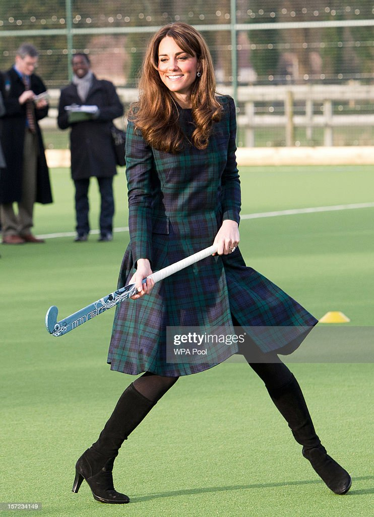 Catherine, Duchess of Cambridge takes part in a day of activities and festivities to mark the occasion of St Andrew's Day at St Andrew's School on November 30, 2012 in Pangbourne, Berkshire, England. The Duchess visited the Pre-Prep School for under-5s, unveiled a plaque to officially open a new artificial turf playing field and met members of the school's hockey team, which she played for during her time as a pupil at the school (1986-1995). The Duchess also toured the school privately and watched the school's Progressive Games which are traditional games played indoors by teachers and students on St. Andrew's Day.