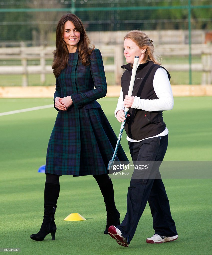 Catherine, Duchess of Cambridge (L) takes part in a day of activities and festivities to mark the occasion of St Andrew's Day at St Andrew's School on November 30, 2012 in Pangbourne, Berkshire, England. The Duchess visited the Pre-Prep School for under-5s, unveiled a plaque to officially open a new artificial turf playing field and met members of the school's hockey team, which she played for during her time as a pupil at the school (1986-1995). The Duchess also toured the school privately and watched the school's Progressive Games which are traditional games played indoors by teachers and students on St. Andrew's Day.