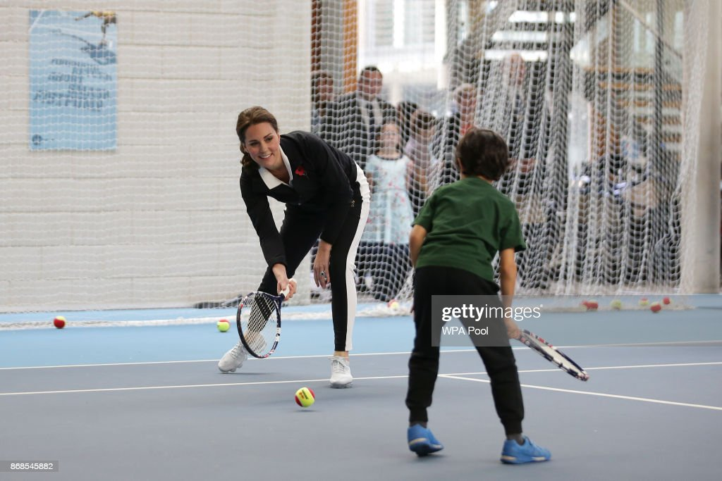 Catherine, Duchess of Cambridge, takes part in a Tennis for Kids session during a visit at the Lawn Tennis Association (LTA) at the National Tennis Centre on October 31, 2017 in southwest London, England. The Duchess of Cambridge, who became Patron of the LTA in December 2016, visited the LTA, the national governing body of tennis in Great Britain, where she was briefed on the organisations latest activities and objectives, and had the opportunity to watch a number of tennis demonstrations at the National Tennis Centre's on-court facilities.