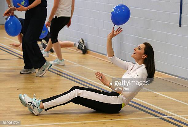 Catherine Duchess of Cambridge takes part in a tennis workshop with Andy Murray's mother Judy at Craigmount High School in Edinburgh on February 24...