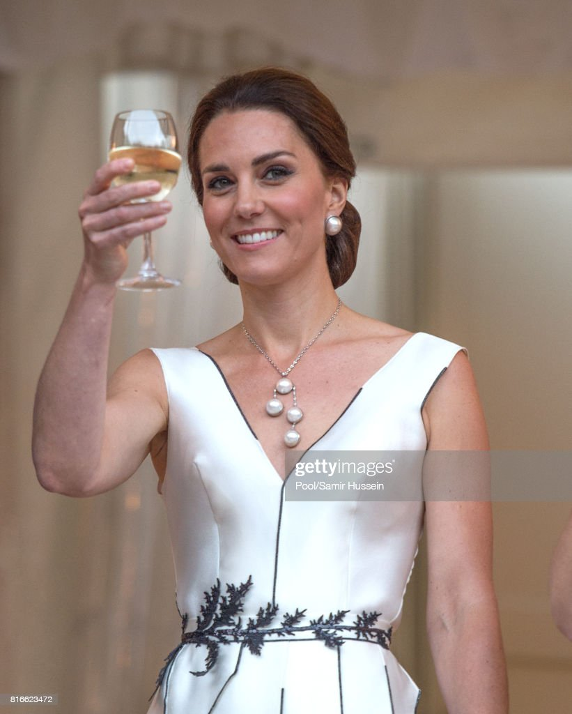 Catherine, Duchess of Cambridge takes part in a toast as she attends the Queen's Birthday Garden Party at the Orangeryeduring an official visit to Poland and Germany on July 17, 2017 in Warsaw, Poland.