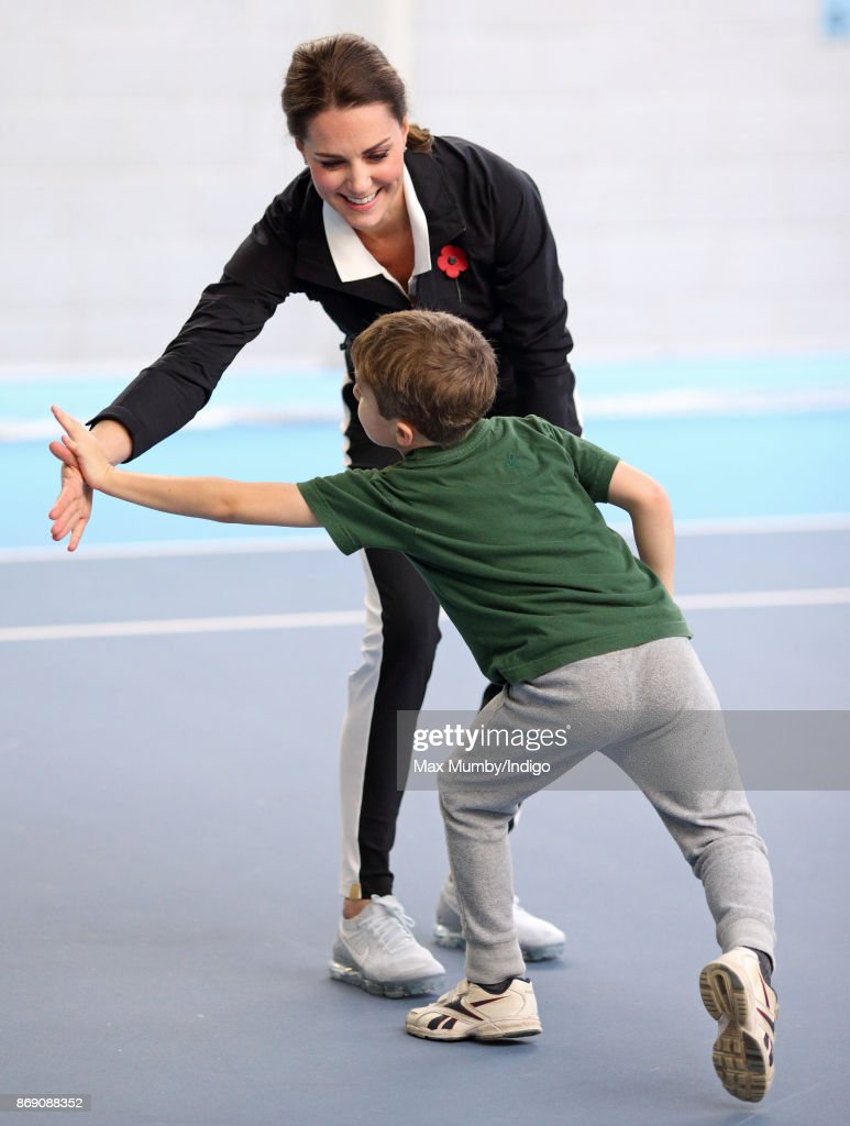 Catherine, Duchess of Cambridge takes part in activities with school children during a visit to the Lawn Tennis Association at the National Tennis Centre on October 31, 2017 in London, England. The Duchess of Cambridge became Patron of the LTA in December 2016.