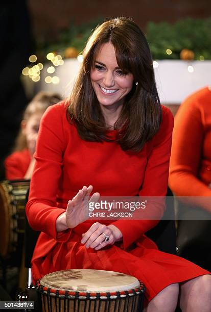 Catherine Duchess of Cambridge takes part in some drumming 'music therapy' as she attends the Anna Freud Centre Family School Christmas Party at the...